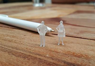 Two 3D figures on a table